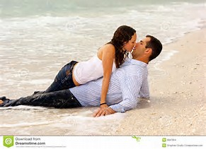 KISSING BY THE SEA AND SAND